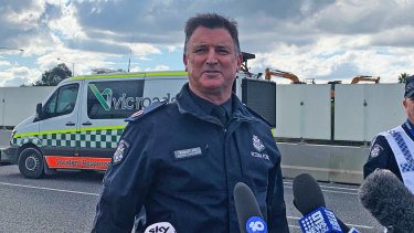 Assistant Commissioner Bob Hill speaking at the scene on Thursday.