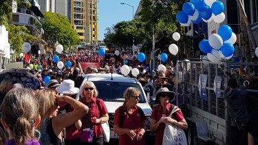 Adegan dari pawai Hari Buruh di Brisbane pada hari Senin.