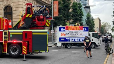 A fire truck with large cherry picker attachment was brought in to deal with the protest.