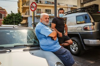 Romeo Khalil waits hours for fuel so he can still work as a taxi driver.