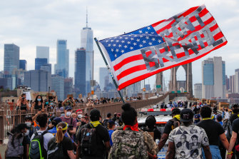 Protesters march across the Brooklyn Bridge in New York.