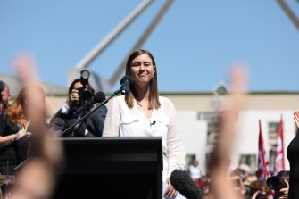 Brittany Higgins addresses thousands of people outside Parliament House.