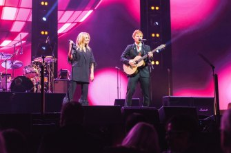 Kylie Minogue and English singer Ed Sheeran perform together at the state memorial service for Australian music legend Michael Gudinski.