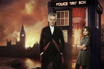 Peter Capaldi and Jenna Coleman in front of Dr Who's TARDIS.