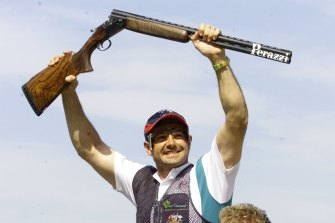 Australian shooter Michael Diamond celebrates after winning the gold medal in the Men's Trap Final at the Sydney International Shooting Centre.