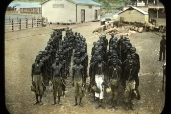 "A photo titled: ""Group of prisoners in neck chains, Wyndham, Western Australia"", dated between 1898 and 1906."