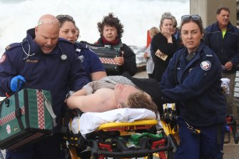 Ambulance officers take a teenager to Royal North Shore Hospital on Wednesday.