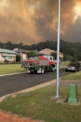 Bushfires associated with climate change can cause havoc in small communities frequented by holidaymakers, such as this fire in Tathra, NSW, in March 2018.