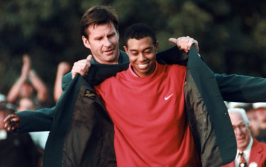 Tiger changed everything: Nick Faldo presents Tiger Woods with his first green jacket in 1997.