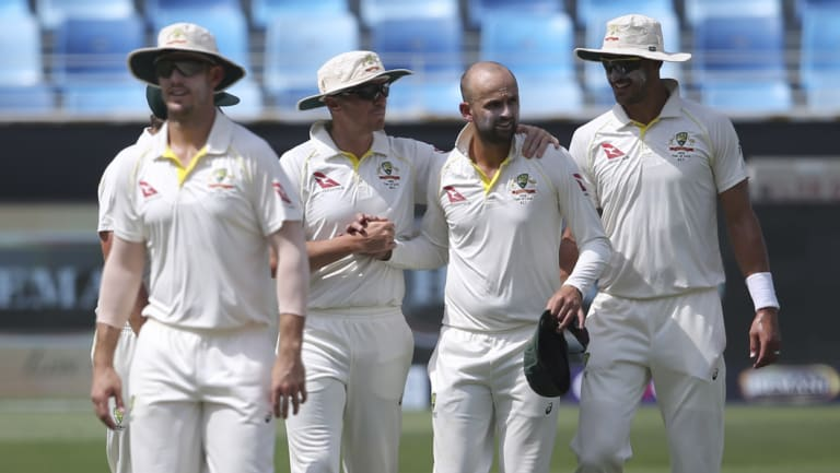 Nathan Lyon (second right) is planning a quiet night with his skipper.