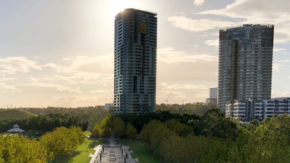 The 33-storey Opal Tower, left, was completed in August.