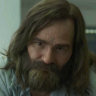 Damon Herriman as Charles Manson in Mindhunter.