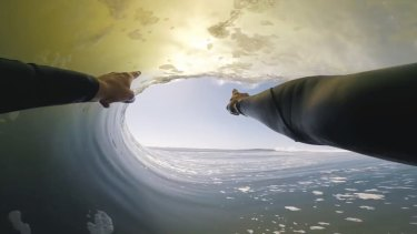 Ride of his life: In this image made from video provided by Chris Rogers, surfer Koa Smith points at a wave during his two-minute ride off the coast of Namibia.