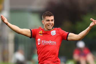 Nathan Konstandopoulos is all smiles after scoring for Adelaide United.