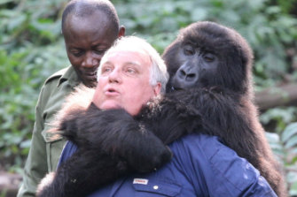 In Africa with an orphaned mountain gorilla; the species' dwindling population was an early focus of his philanthropy.