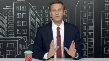 Russian opposition leader Alexei Navalny speaks as he records a speech about his investigation into large-scale corruption at the National Guard. Foundation, in August.
