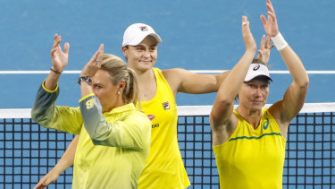 Sam Stosur, right, bounced back from a horrible defeat to win the doubles with Ash Barty.