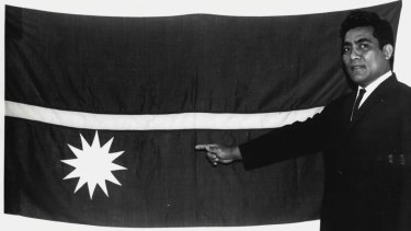 Theodore Moses, an officer at the Republic of Nauru's Melbourne office, unveils the Nauruan National flag on February 2, 1968.