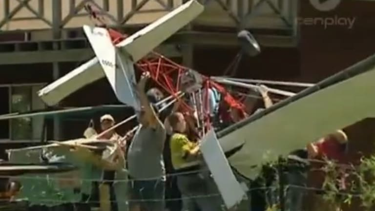 The damaged aircraft being carried out of the yard.