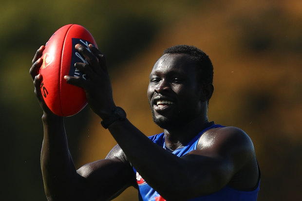 Majak Daw joins the Demons for their training session at Casey Fields on Tuesday.