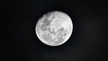 The moon may hold frozen water in more places than suspected
