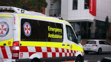 Child taken to hospital after falling from inner city apartment block