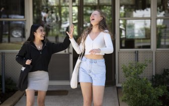 Clare Wilkes (right) and Andrhea Alabe from St Marys Senior High School leave their last HSC exam on November 11.