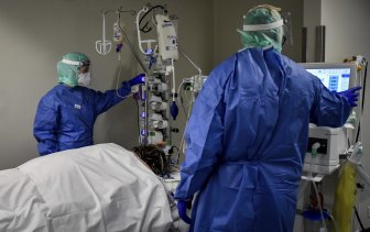 Medical staff treat a coronavirus patient in an intensive care unit in Brescia, Italy, on Thursday.