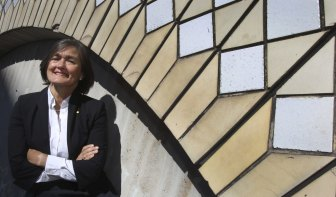 Sydney opera house chief executive Louise Herron against some of the tiles that adorn the side of the sails.