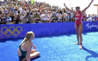 So close... Brigitte McMahon celebrates as Michellie Jones watches on after the triathlon.