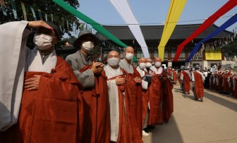 South Korean buddhist monks welcome pilgrims at Bongeun Temple in Seoul this week.