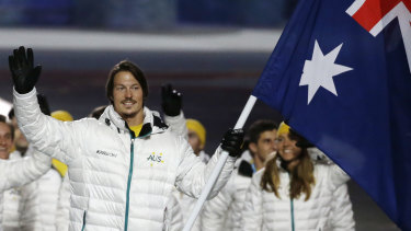 Pullin carries the flag as he leads his team during the opening ceremony of the 2014 Winter Olympics in Sochi, Russia.
