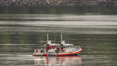 Two US Coast Guard response boats search George Inlet on Tuesday.