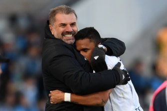 Ange Postecoglou embraces Yokohama F. Marinos striker Erik during Saturday's crucial win over Kawasaki Frontale.