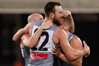 Port secured the minor premiership by beating Collingwood on Monday night.