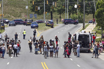 Protesters block a road near the Wendy's fast food restaurant in Atlanta on Saturday where Rayshard Brooks was killed.