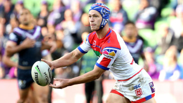 Friend to foe: Kalyn Ponga distributes for the Knights. If Pearce is selected for the Blues, Ponga will present a significant challenge.