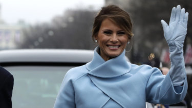 US first lady Melania Trump waves during her husband's inauguration parade on Pennsylvania Avenue, Washington, in 2016.