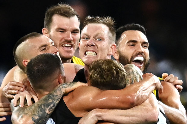 BRISBANE, AUSTRALIA - OCTOBER 24: Jack Riewoldt of the Tigers celebrates kicking a goal with team mates during the 2020 AFL Grand Final match between the Richmond Tigers and the Geelong Cats at The Gabba on October 24, 2020 in Brisbane, Australia. (Photo by Quinn Rooney/Getty Images)