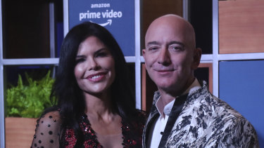 The glamour days are over: News anchor Lauren Sanchez and Amazon CEO Jeff Bezos in January.