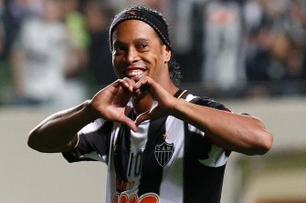 Ronaldinho has been freed from prison and placed under house arrest after posting a seven-figure bail sum.