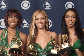"""""""Destiny's Child,"""" (L-R) Kelly Rowland, Beyonce Knowles and Michelle Williams, pose with the Grammys they won at the 43rd annual Grammy Awards backstage at the Staples Center on February 21, 2001 in Los Angeles."""