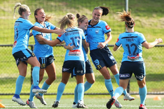 Ellie Brush celebrates with her Sydney FC teammates after scoring the second goal against the Western Sydney Wanderers on Saturday.
