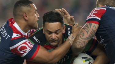 No way through: John Sutton is squeezed on a night highlighted by an impenetrable Roosters defence.