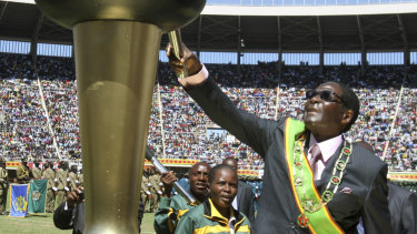 Mugabe lights a flame at celebrations to mark 32 years of independence of Zimbabwe in 2012.
