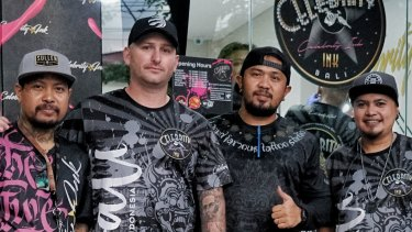 Dane Herden, owner of Celebrity Ink Tattoo Bali studio (2nd from left) with Gede Supala (Left) and some of the studio's senior tattoo artists.