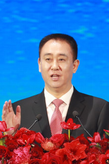 Evergrande founder Hui Ka Yan  delivers the keynote speech in November 2019 at a summit aimed towards promoting a new energy vehicle  development.