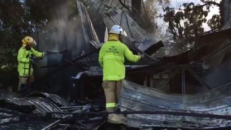 Lovestar owner Helen Bayley surveys the damage to her Moggill warehouse after a fire on Monday.