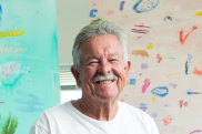 Ken Done in his Sydney studio where the mottos inside the studio door read: PAINT FOR ME and FEARLESS.