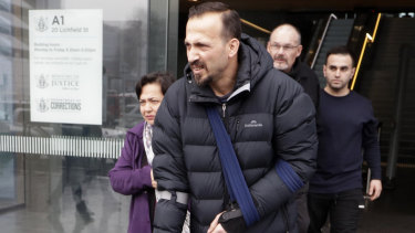 Temel Atacocugu, a victim of the Christchurch mosque shootings, leaves court in Christchurch last year.